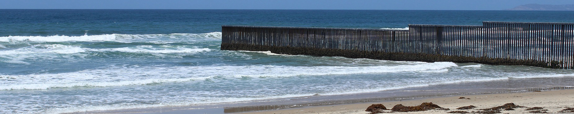 border fence in ocean between Mexico and San Diego