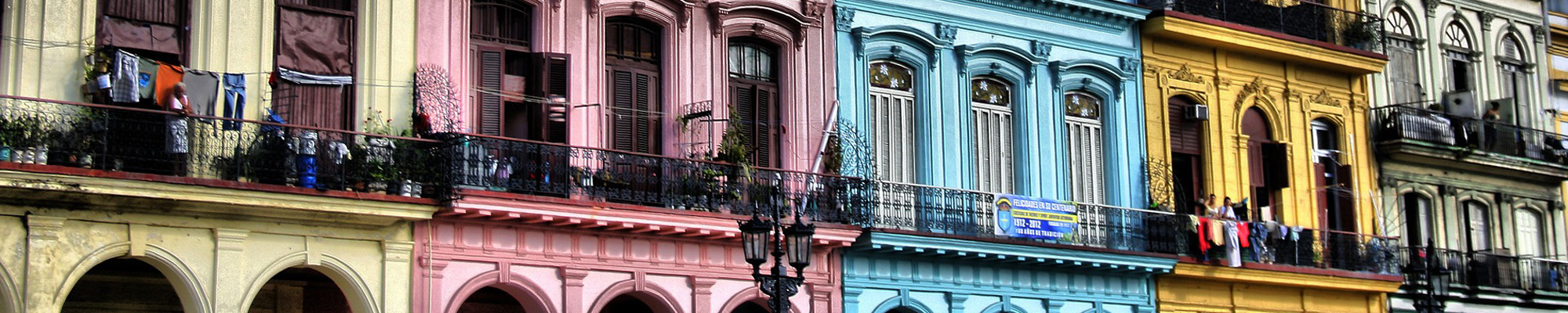 balconies of colorful buildings in cuba